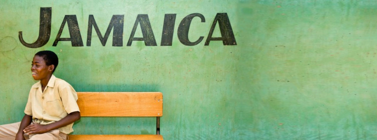 Jamaica - Boy sitting on a bench